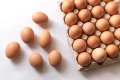 123/5000 Fresh chicken eggs on a white background. Fresh chicken eggs in the wrapping several eggs laid on a white background Royalty Free Stock Images