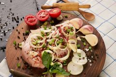 Fresh chicken fillet with fresh vegetables mushrooms. Onion rosemary and seasoning spices on dark wooden board. Culinary cooking ingredients. Healthy diet food Royalty Free Stock Photos
