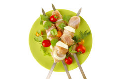 Fresh chicken kebabs on dark Royalty Free Stock Photography