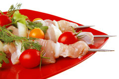 Fresh chicken kebabs on plate Stock Images