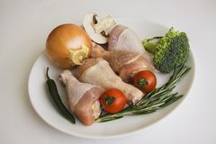 Fresh chicken legs, broccoli, tomato and onion horizontal Stock Image