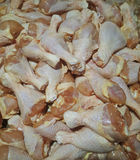 Fresh chicken legs. Chickens are the most common type of poultry in the world,and were some of the first domesticated animals.they are a major world wide source Stock Photo