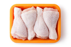 Fresh chicken legs on the retail tray. Top view. Royalty Free Stock Photo