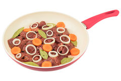 Fresh chicken liver with carrot  in a white frying pan Stock Photos