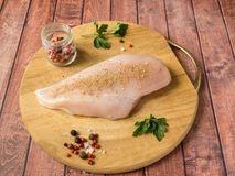 Fresh chicken meat on wooden board on table. Selective focus, horizontal. Fresh chicken meat on wooden board on table. Selective focus, horizontal Stock Photography