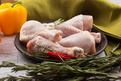 Fresh chicken on plate on wooden table Stock Photography