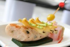 Fresh chicken sausage on plate Stock Photo