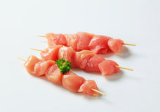 Fresh chicken skewers. Pieces of raw chicken meat on skewers royalty free stock photo