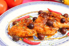 Fresh chicken. Some fresh chicken wings with olives royalty free stock image