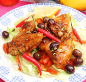 Fresh chicken. Some fresh chicken wings with olives stock image