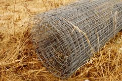 Fresh Chicken Wire. A roll of fresh chicken wire mesh for keeping the birds domesticated stock photos