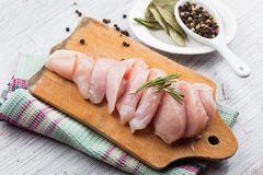 Fresh chicken on wooden board Stock Photography