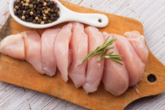 Fresh chicken on wooden table Royalty Free Stock Photos