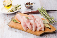 Fresh chicken on wooden table Royalty Free Stock Images