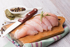 Fresh chicken on wooden table Stock Image