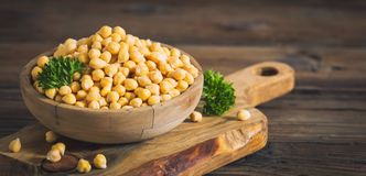 Fresh chickpeas in wooden bowl Royalty Free Stock Photo