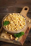 Fresh chickpeas in wooden bowl Stock Photography