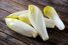 Fresh Chicory Salad. On  rustic wooden table Royalty Free Stock Photos