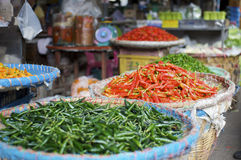 Fresh chili pepper at an asian street market. Fresh green and red chili pepper at a street fruits and vegetable market in Bangkok, Thailand Royalty Free Stock Image