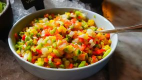 Fresh Chilled Salsa in Bowl. Fresh Colorful Salsa in Bowl Chilled over ice with spoon with tomatoes, onions, peppers, jalapeno Royalty Free Stock Photo