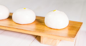 Fresh Chinese Bun on wooden tray Stock Photos