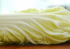 Fresh Chinese cabbage with drop of water on cutting board Stock Photo