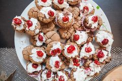 Choco Muffins with cherry  homemade dessert served on table Royalty Free Stock Photography
