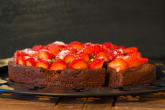 Fresh chocolate cake wit red strawberries Stock Images