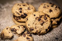 Chocolate chip cookies on rustic background royalty free stock images