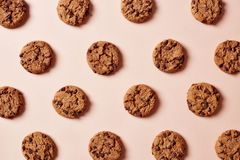 Fresh chocolate chip cookies pattern on pink background royalty free stock image