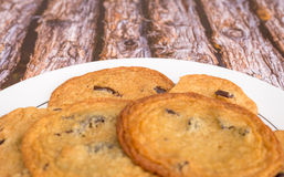 Fresh chocolate chip cookies on a wood background. Royalty Free Stock Image