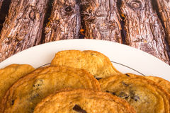 Fresh chocolate chip cookies on a wood background. Royalty Free Stock Images