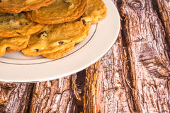 Fresh chocolate chip cookies on a wood background. Stock Photo