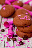 Fresh chocolate cookies, coffee beans, pink ribbons and confetti Stock Photography