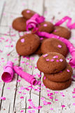 Fresh chocolate cookies, coffee beans, pink ribbons and confetti Stock Images