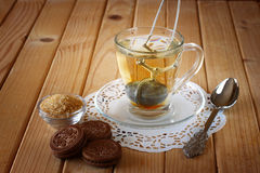 Fresh chocolate cookies and hot black tea over wooden table Royalty Free Stock Photos