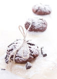 Fresh chocolate cookies on perchament  background Royalty Free Stock Image