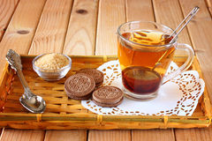 Fresh chocolate cookies and tea cup over wooden table Royalty Free Stock Photography