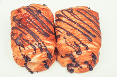 Fresh chocolate croissants on white background Stock Photography