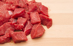 Fresh chopped beef steak. On wooden chopping board royalty free stock photography