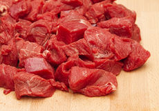 Fresh chopped beef steak on chopping board Royalty Free Stock Image