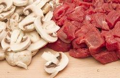 Fresh chopped beef steak and mushrooms Stock Image