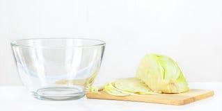 Fresh chopped cabbage on a cutting board. Closeup Stock Photo