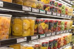 Fresh chopped and chunks fruits plastic box on display in. Fresh chopped and chunks fruit plastic box display in store at Houston, Texas, US. In-house cut Royalty Free Stock Image