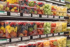 Fresh chopped and chunks fruits plastic box on display in. Fresh chopped and chunks fruit plastic box display in store at Houston, Texas, US. In-house cut Stock Images