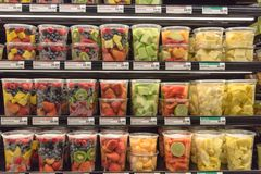 Fresh chopped and chunks fruits plastic box on display in. Fresh chopped and chunks fruit plastic box display in store at Houston, Texas, US. In-house cut Stock Photo