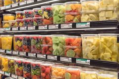 Fresh chopped and chunks fruits plastic box on display in. Fresh chopped and chunks fruit plastic box display in store at Houston, Texas, US. In-house cut Royalty Free Stock Photos