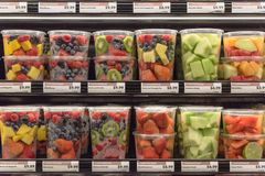 Fresh chopped and chunks fruits plastic box on display in. Fresh chopped and chunks fruit plastic box display in store at Houston, Texas, US. In-house cut Stock Image