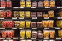 Fresh chopped and chunks fruits plastic box on display in stock photos