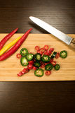 Fresh, chopped hot peppers on cutting board Royalty Free Stock Photo